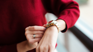 Woman looking at her watch as the end of financial year approaches