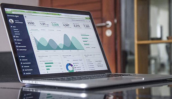 Business laptop with graphs and data